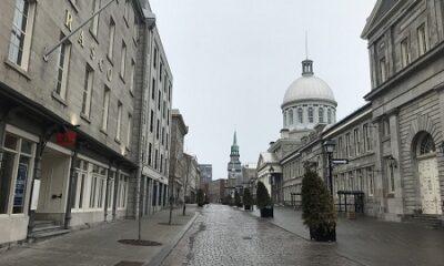 Vieux-Montréal. La vue sur la rue Saint-Paul en avril 2020 n'est pas certainement très différente telle qu'on voyait cette rue en novembre 1918, en pleine pandémie. Photo de GrandQuebec.com.